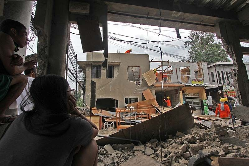 LONG WAIT. After a years-long wait, the University of the Philippines Cebu begins recovery of its property that was occupied by more than 60 families in Sitio Avocado, Barangay Lahug, Cebu City. The court sheriff implemented the writ of demolition in the area on Wednesday, Aug. 7, 2019. (SunStar photo/Amper Campaña)
