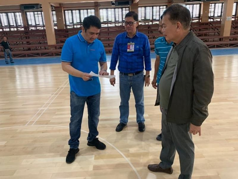 INSPECTION. Deputy Speaker Aurelio Gonzales Jr. checks the details of the newly installed flooring of the DHVSU gymnasium. With him are President Dr. Enrique Baking and Vice President for Administration and Finance Dr. Reynaldo Nicdao. (Ian Ocampo Flora)