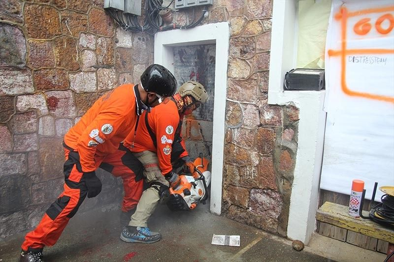 BAGUIO. Rescuers arrive at the Baguio City Hall past 2PM to save trapped individuals during the simultaneous earthquake drill on Thursday, August 8. The responders are Baguio City Hall employees who completed their Disaster Rescue course. (Photo by Jean Nicole Cortes)