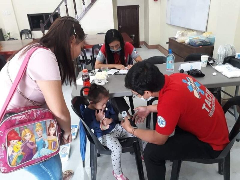 TACLOBAN. A parent brings her child for a free dengue rapid test at the Tingog party-list headquarters in Tacloban City. (Contributed photo)