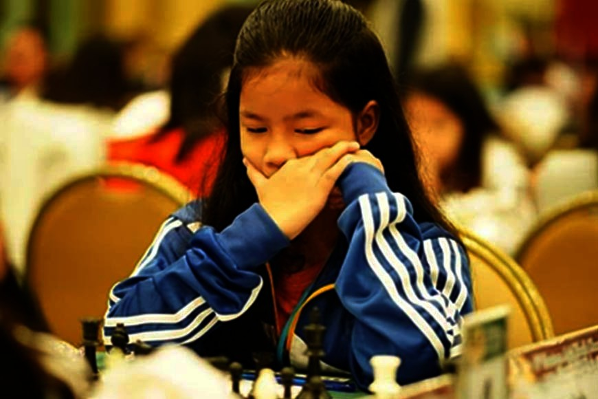 "CAGAYAN DE ORO. Ruelle ""Tawing"" Canino wins the blitz gold medal with a dominating performance in the under-12 girls section of the Eastern Asia Youth Chess Championships in Bangkok, Thailand -- winning all her nine games and leading the Philippines to a 1-2-3 finish, with Kaye Lalaine Regidor winning silver and April Joy Claros getting bronze. [Photo from timeline of Maria Gina Andres Canino]"