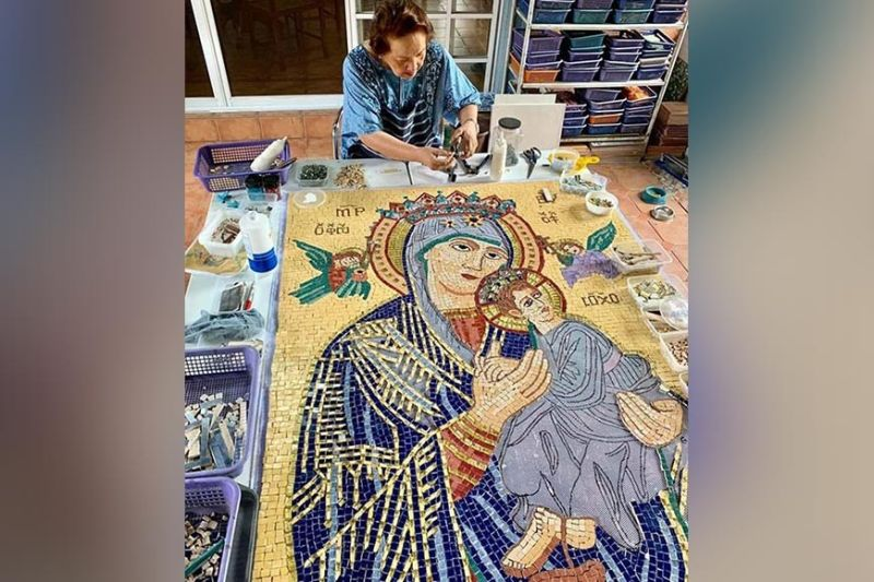 BACOLOD. Mosaic artist Gigi Campos felt grateful and blessed to be working on her latest mosaic mural art piece - The Our Lady of Perpetual Help, made of ceramic and glass tesserae. It is 4-ft wide and 6-ft. high. (Contributed photo)