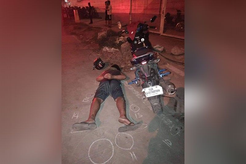 HANDCUFFED. One of the two men who allegedly engaged policemen in a shootout in Liloan town is seen handcuffed even when he was already on the ground. (Contributed photo)