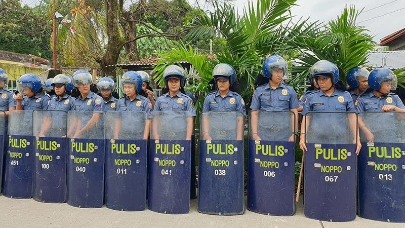 BACOLOD. Members of the local composite (anti-riot) team positioned themselves outside the main office of Vallacar Transit, Inc. in Mansilingan, Bacolod City, August 8, 2019. (Contributed photo)