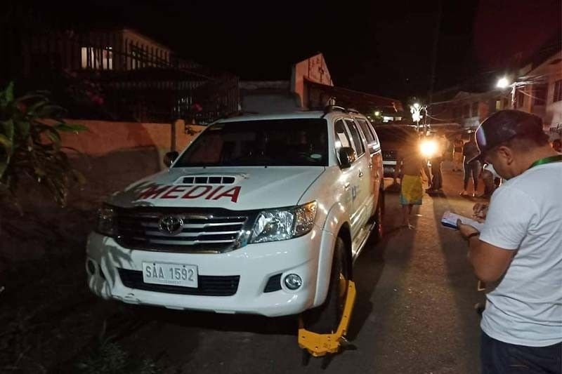 NO EXCEPTION. Members of the Cebu City Transportation Office clamp a vehicle belonging to a government-owned television network as the traffic office goes after violators who defy the prohibition on overnight parking. (Photo grabbed from CCTO's facebook page)