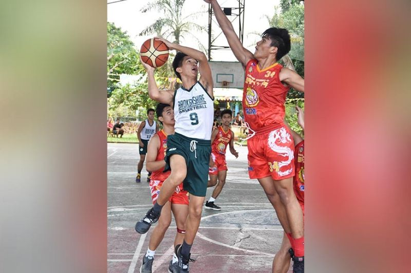 DAVAO. Brokenshire Science High School slasher Paul Divinagracia makes a strong drive past Philippine Academy of Sakya Center Kurt Magbanua in a Davao Youth Basketball League 2019 juniors game held recently at Margarita Gym, J.P. Laurel Avenue, Davao City. (Rael Diaz)