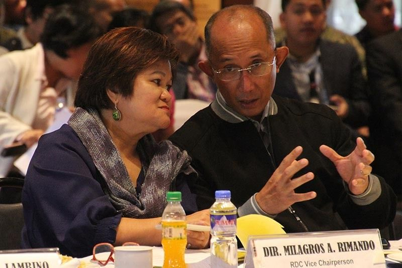 BAGUIO. Baguio City Mayor Benjamin Magalong discuss matters with Regional Development Council (RDC) vice chairperson Milagros Rimando during the Regional Development Council (RDC) and Regional Peace and Order Council (RPOC) third quarter meeting on Thursday, August 8 at The Mansion. (Photo by Jean Nicole Cortes)