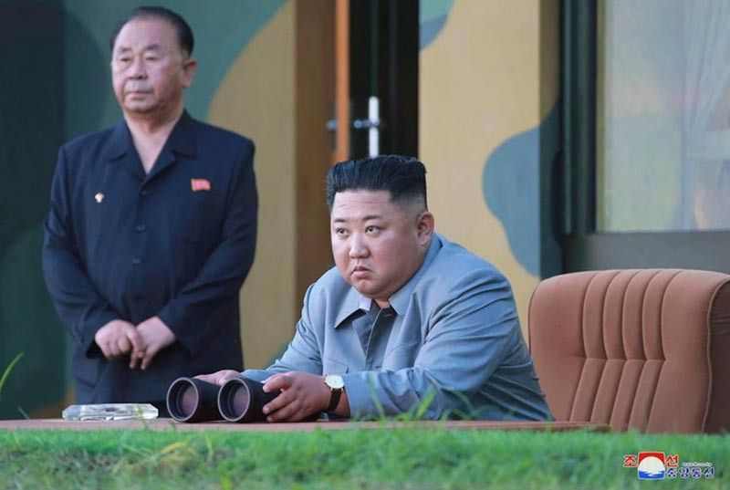 NORTH KOREA. In this July 25, 2019, photo provided on Friday, July 26, 2019, by the North Korean government, North Korean leader Kim Jong Un watches a missile test in North Korea. North Korea on Saturday, Aug. 10, 2019, extended a recent streak of weapons display by firing projectiles twice into the sea, according to South Korea's military. Independent journalists were not given access to cover the event depicted in this image distributed by the North Korean government. The content of this image is as provided and cannot be independently verified. Korean language watermark on image as provided by source reads: