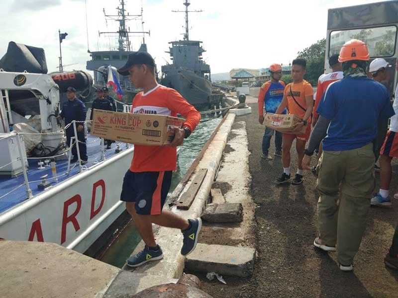 RELIEF GOODS. Food and other supplies bound for Olango were loaded on a Coast Guard ship on Friday, Aug. 9, 2019, ending days of isolation for the island. (SunStar photo/Herty Lopez)