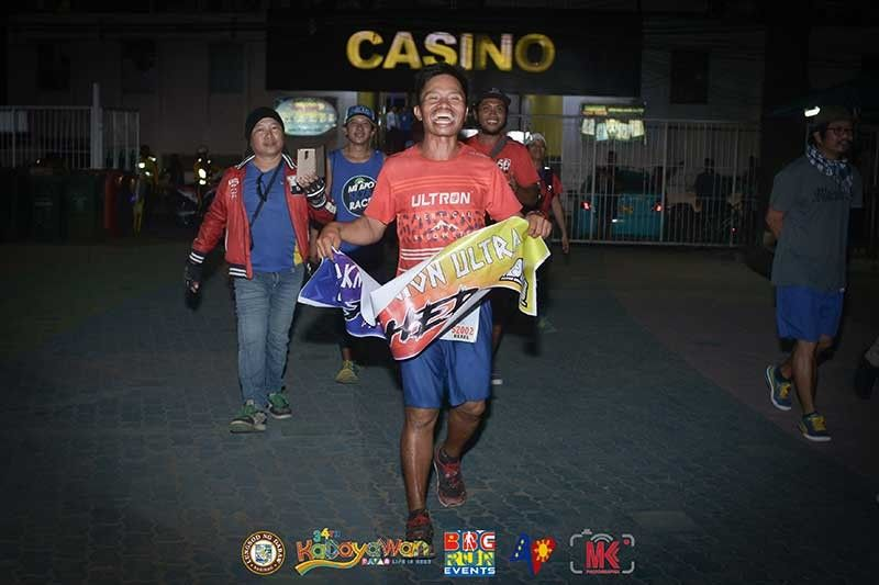 DAVAO. Rexel Aguirre of Team Tadeco celebrates reaching the finish line of the 34th Kadayawan Sports Festival DRU520 Davao Region Ultramarathon at People's Park in Davao City Saturday, August 10, 2019. (Marvin Ponce/Bbg Run Events Facebook)