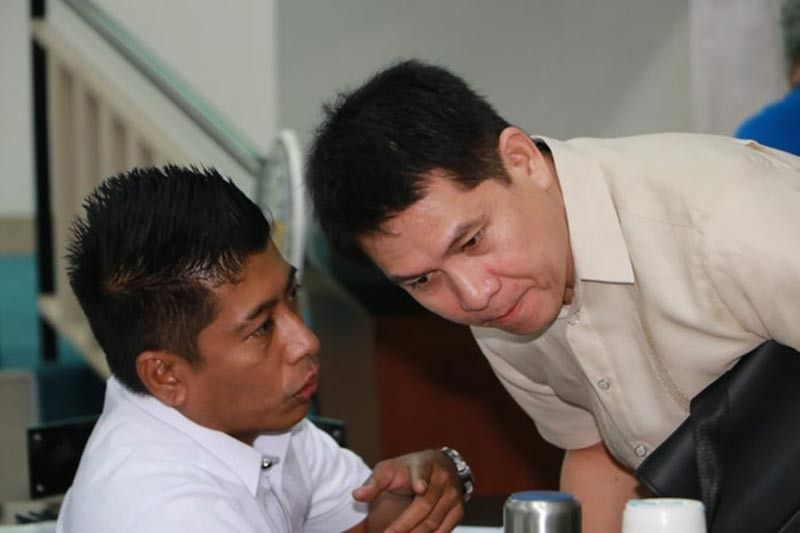 PAMPANGA. Angeles City Councilors Jay Sangil and Pogs Suller in a huddle during a recent hearing on internet service. (Contributed photo)