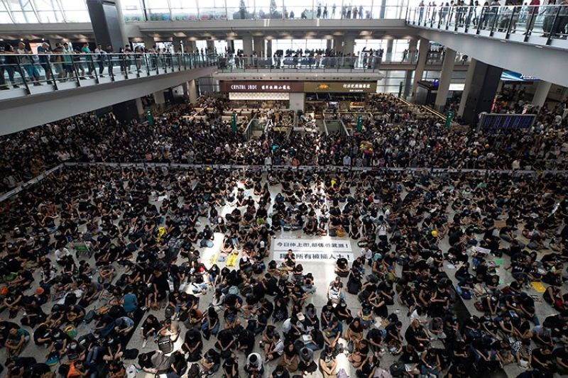 HONG KONG. Protesters surround banners that read