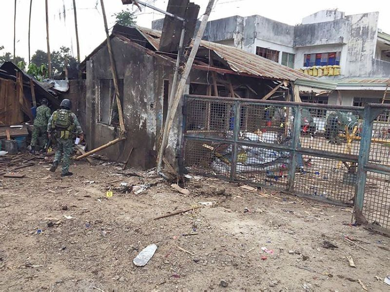 SULU. In this June 28, 2019 photo, troops examine the scene of the suicide attack carried out by terrorists at a military camp in Indanan, Sulu. (File Photo)