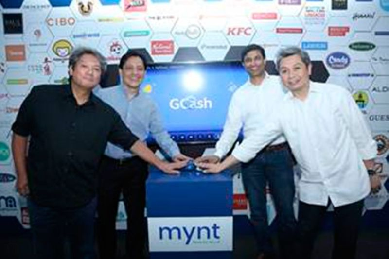 (from left) MyPhone chief executive officer David Lim; Sun Life-Philippines chief executive officer and country head Benedict Sison; Mynt chief executive officer Anthony Thomas; and Mynt vice-president for enterprise Luigi Reyes