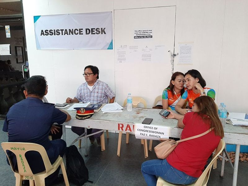 CEBU. Staff of Lapu-Lapu City Representative Paz Radaza put up an assistance desk outside her district office at Lapu-Lapu City Hall that was padlocked Monday, August 12, 2019. (Gregy Magdadaro)