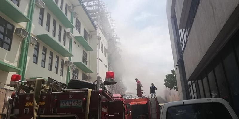 CAGAYAN DE ORO. Firefighters are covered in a thick smoke emitting from the warehouse of PLDT in Carmen, Cagayan de Oro City. (PJ Orias)