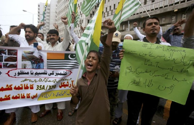 KARACHI, PAKISTAN. Supporters of a religious group Anjum-e-Tulba Islam chant anti-India slogans during a demonstration to condemn India and its decisions on Kashmir, in Karachi, Pakistan, Saturday, August 10, 2019. Pakistan says that with the support of China, it will take up India's unilateral actions in the disputed region of Kashmir with the U.N. Security Council and may approach the U.N. Human Rights Commission over what it says is the
