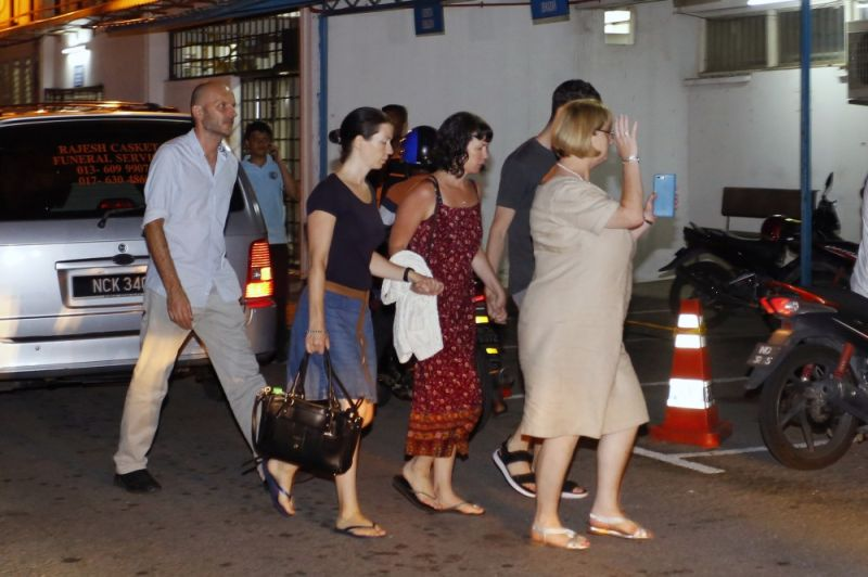 MALAYSIA. Family members of missing British girl Nora Anne Quoirin arrive at a hospital morgue in Seremban, Negeri Sembilan, Malaysia, Tuesday, August 13, 2019. Malaysian police say the family of a missing 15-year-old London girl has positively identified a body found near the nature resort where she disappeared over a week ago. (AP)