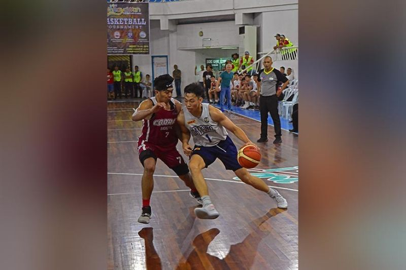 DAVAO. Dave Ildefonso of the National University Bulldogs, seen driving against a Southwestern University Cobras defender in their Kadayawan invitational game Tuesday evening at the Almendras Gym Davao City Recreation Center, is among NU's reliable shooters. (Macky Lim)