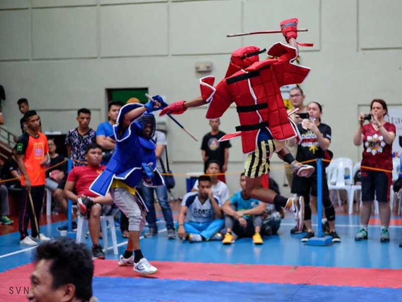 POUNCE. Justin Nepomuceno goes airborne as he attacks his foe in the Cacoy Cañete Doce Pares World Invitationals. (Contributed photo)