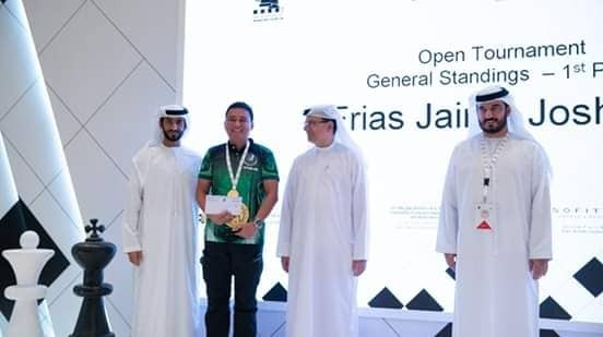 CAGAYAN DE ORO. Cagayan de Oro pride Jaime Joshua Frias II receiving his champ's purse in unrated section of the recent Abu Dhabi International Open chessfest. (Contributed Photo)