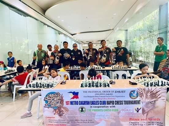 "CAGAYAN DE ORO. Officers of the Metro Cagayan Eagles Club show the signature ""Duterte fist"" gesture in full support of the Parents Chess Club tourney in Cagayan de Oro City. (Contributed Photo)"