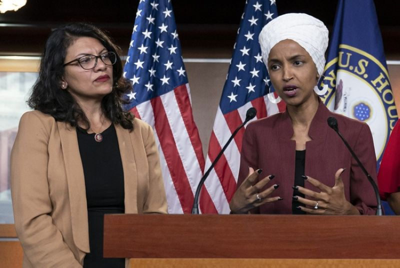 WASHINGTON. In this July 15, 2019, file photo, U.S. Representavies Ilhan Omar, D-Minn, right, speaks, as U.S. Rep. Rashida Tlaib, D-Mich. listens, during a news conference at the Capitol in Washington. The U.S. envoy to Israel said he supports Israel's decision to deny entry to two Muslim congresswomen ahead of their planned visit to Jerusalem and the West Bank. Ambassador David Friedman said Thursday, August 15, 2019, in a statement following the Israeli government's announcement that Israel