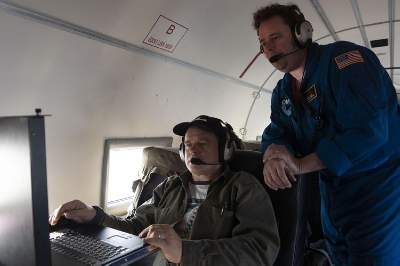 GREENLAND. In this photo taken on Wednesday, August 14, 2019, NASA project manager Ian McCubbin, left, and NASA scientist Josh Willis check data from a probe that they just dropped from a plane as they fly on a mission to track melting ice in eastern Greenland. Greenland has been melting faster in the last decade and this summer, it has seen two of the biggest melts on record since 2012. (AP)
