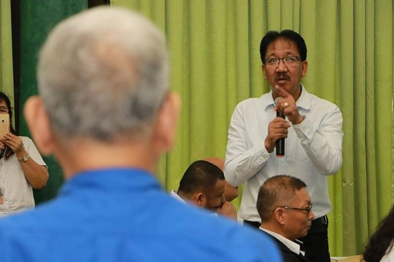 PAMPANGA. Pelco 2 General Manager Amador Guevarra answers accusations hurled by Loi Razon (foreground) during Thursday's (August 15, 2019) public consultation on the