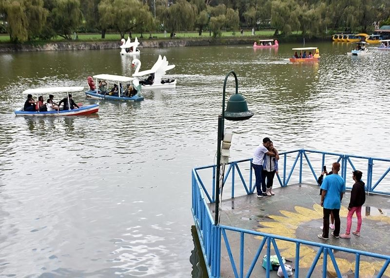 BAGUIO. Tourists take advantage of the improved weather for the boat rides at the Burnham Park Lake Thursday morning, August 15, 2019. The City of Baguio has been battered with heavy rains in the past days due to the enhanced southwest monsoon or habagat. (Redjie Melvic Cawis)