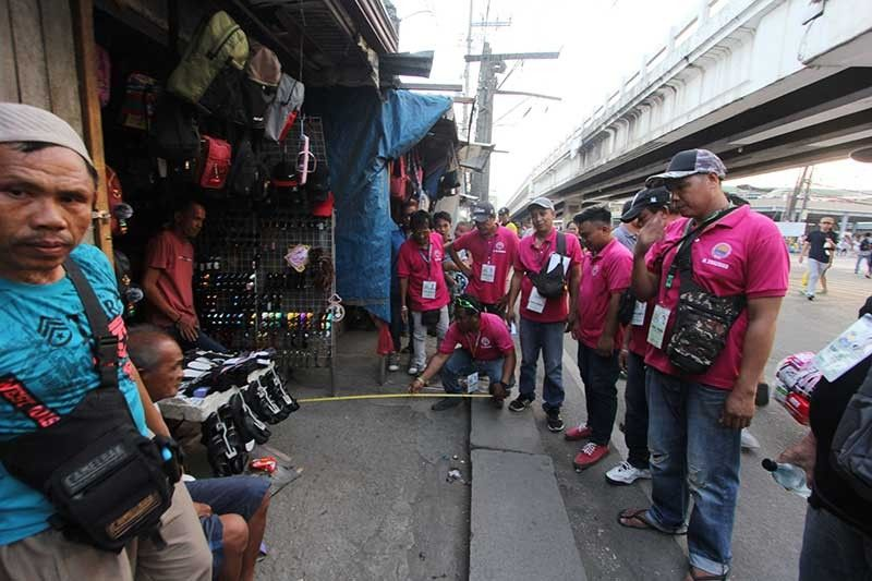 GIVE WAY. The personnel of the clearing team of Talisay City, Cebu inspect a stall on the sidewalk near the flyover in Barangay Tabunok. The City personnel will clear the sidewalks in Tabunok on Saturday, Aug. 17, 2019. (SunStar photo/Amper Campaña)