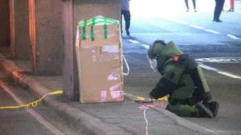 MANILA. A PNP bomb squad member prepares to inspect an abandoned box at Edsa-Shaw Boulevard on August 16, 2019. (Photo by Third Anne Peralta-Malonzo)