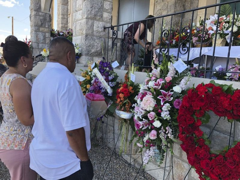EL PASO, TEXAS. Mourners deliver flowers on Friday, August 16, 2019, for the funeral in El Paso, Texas, of Margie Reckard, 63, who was killed by a gunman in a mass shooting earlier in the month. Hundreds of strangers from El Paso and around the country came to pay their respects Friday after her husband, Antonio Basco, said he felt alone planning her funeral. He invited the world to join him in remembering his companion of 22 years. (AP)