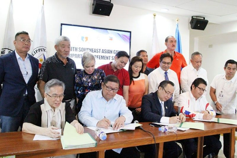 "MANILA. Officials of the Philippine Sports Commission, Philippine Olympic Committee and Philippine SEA Games Organizational Committee Foundation, Inc. (Phisgoc) formally sign tripartite agreement at the PSC Conference Room at the Rizal Memorial Sports Complex, Manila. Signed by (seated from left) POC chairman Steve Honteveros, PSC chairman William ""Butch"" Ramirez, POC president Abraham Tolentino and and Phisgoc chief executive officer Ramon Suzara, the agreement aims provide smooth sailing hosting of the 30th Southeast Asian Games from November 30 to December 11, 2019. (Photo by PNA)"