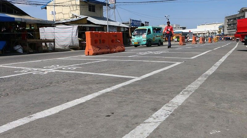 TACLOBAN CITY. A city personnel surveys the street markings for the Night Market stalls along Quezon Boulevard where displaced vendors can sell their goods. (Photo courtesy of K.E. Napala/Tacloban City Information Office)