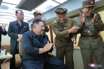 NORTH KOREA. In this Friday, August 16, 2019, photo provided Saturday, August 17, by the North Korean government, North Korean leader Kim Jong Un, center, watches the test firing of an unspecified new weapon at an undisclosed location in North Korea. North Korea on Saturday said leader Kim supervised another test-firing of an unspecified new weapon that extended a streak of weapons demonstrations seen as an attempt to pressure Washington and Seoul over slow nuclear negotiations and their joint military exercises. The content of this image is as provided and cannot be independently verified. Korean language watermark on image as provided by source reads: