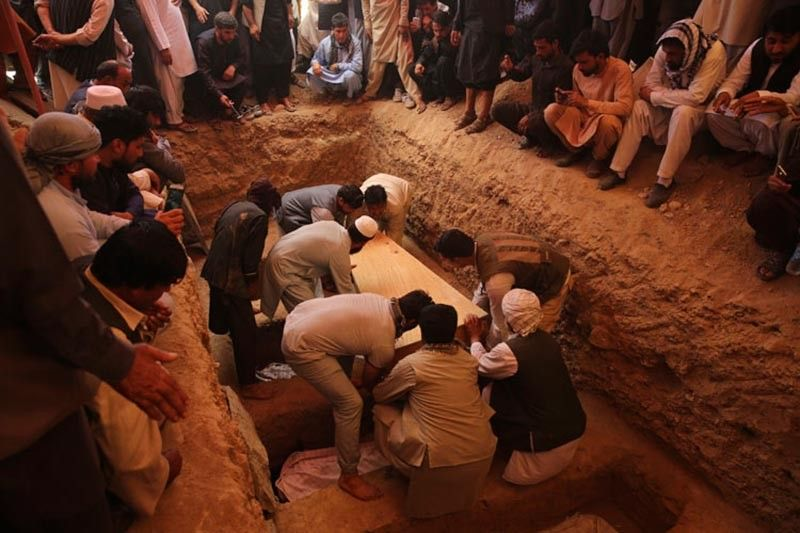 KABUL, AFGHANISTAN. Afghans bury the bodies of victims of the Dubai City wedding hall bombing during a mass funeral in Kabul, Afghanistan, Sunday, August 18, 2019. The deadly bombing at the wedding in Afghanistan's capital late Saturday that killed dozens of people was a stark reminder that the war-weary country faces daily threats not only from the long-established Taliban but also from a brutal local affiliate of the Islamic State group, which claimed responsibility for the attack. (AP)