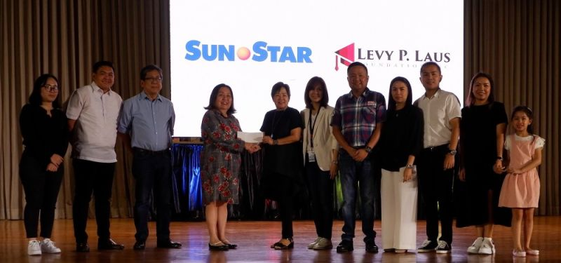 PAMPANGA. SunStar Management president Gina Atienza, together with SunMan executives Ashley Aguirre, Tony Orejas and now retired SunStar Pampanga general manager Jun Sula, hands over a check donation from SunStar Pampanga to the Laus family led by Tess Laus, widow of the late LausGroup chairman and founder Levy P. Laus, for the Levy P. Laus Foundation during the latter's 69th birth anniversary on August 17 at the LausGroup Event Centre in the City of San Fernando. (Photo by JTD)