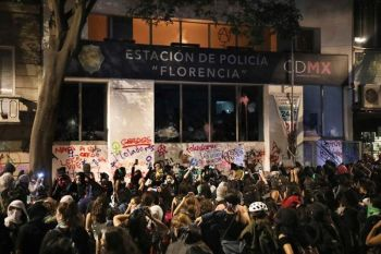 MEXICO CITY. Female demonstrators stand outside a defaced police station as they watch the second floor burn, from a fire they started, during a protest sparked by a string of alleged sexual attacks by police officers, in Mexico City, Friday, August 16, 2019. On Friday, hundreds of women demonstrated largely peacefully in downtown Mexico City with pink spray paint and smoke. But some protesters trashed the nearby bus station and a police station. This week, an auxiliary policeman was held for trial on charges he raped a young female employee at a city museum. (AP)