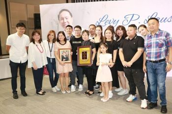 PAMPANGA. Bank of Florida chairman and president Teresa David-Carlos hands over to the Laus family led by Tess Laus a board resolution and portrait of the late LausGroup chairman and founder Levy P. Laus in recognition of his contributions to the bank as chairman of the board in 2018-2019 during the latter's birth anniversary at the LausGroup Event Centre in the City of San Fernando. (Photo by Chris Navarro)