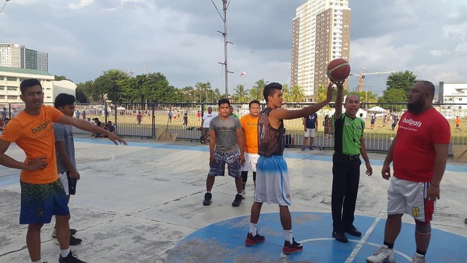 CAGAYAN DE ORO. Ceremonial tip-off with Cagayan de Oro's top whistle man Panot Sambaan at Pelaez Sports Center. (Lynde Salgados)
