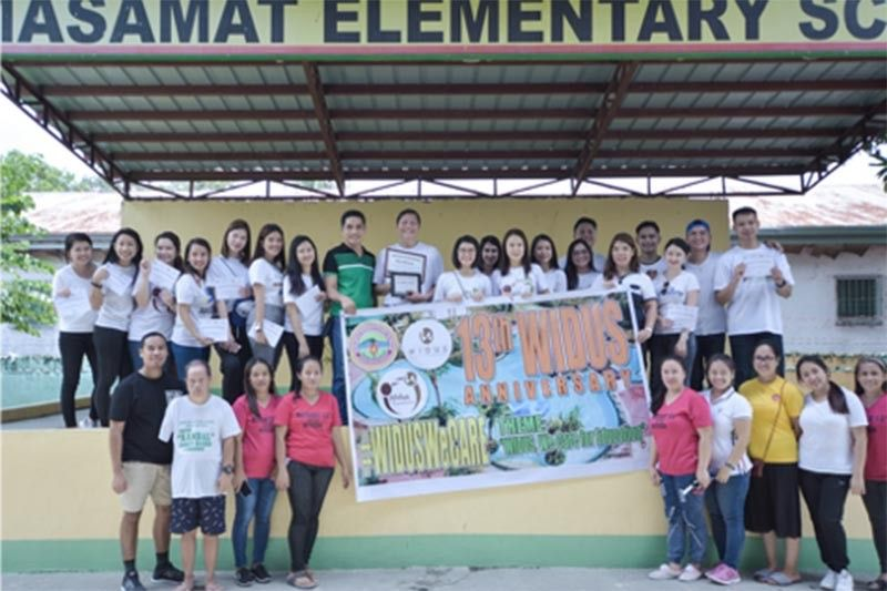 PAMPANGA. Widus Foundation provides aid to Masamat Elementary School in Mexico town as part of Widus International Leisure Inc.'s 13th founding anniversary. (Contributed photo)