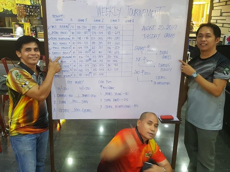 DAVAO. Ivan Awid, Darius Beloy and Cedric Alimbuyong pose at the scoreboard after grabbing the first three spots of the Datba Weekly Bowling Tournament held Tuesday evening, August 20, 2019, at the SM Lanang Premier Bowling Center in Davao City. (Jesrael Rule Facebook)