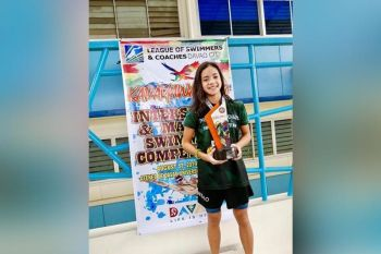 DAVAO. Liaa Margarette and Lora Micah Amoguis are hailed most outstanding swimmers in their respective categories in the recently-concluded 2019 Kadayawan Festival Inter-School and Masters Competition at the Fr. Rodolfo A. Malasmas SJ swimming pool, Ateneo de Davao University, Matina, Davao City. (Cynthia Amoguis)