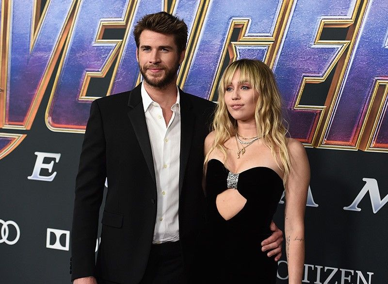 "In this Monday, April 22, 2019, file photo, Liam Hemsworth, left, and Miley Cyrus arrive at the premiere of ""Avengers: Endgame"" at the Los Angeles Convention Center. Liam Hemsworth is seeking a divorce from Miley Cyrus after seven months of marriage. The 29-year-old Australian actor filed for the dissolution of his marriage to the 26-year-old American pop star in Los Angeles Superior Court on Wednesday, Aug. 21, 2019. (AP File)"