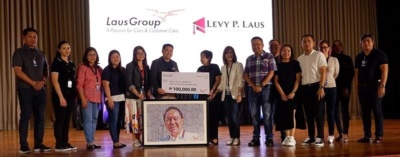 PAMPANGA. Members of the LausGroup Executive Committee, headed by COO Alfie Adriano, hand over a check donation to the Laus family led by Tess Laus, widow of the late LausGroup chairman and founder Levy P. Laus, for the Levy P. Laus Foundation. (Jovi T. De Leon)