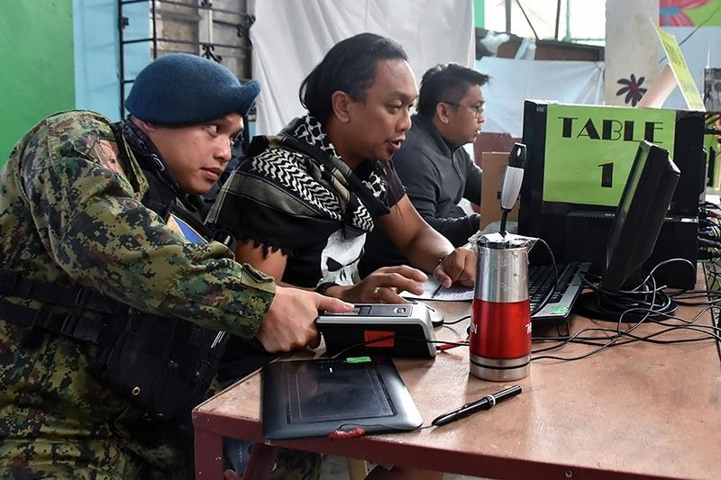 BAGUIO. A member of the Baguio City Police Office registers as a new voter in Baguio City during the Satellite Voter Registration of the Commission on Elections held at the Holy Ghost Extension Barangay Hall. (Redjie Melvic Cawis)