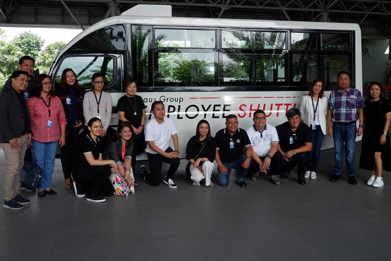 PAMPANGA. Members of the LausGroup executive committee and the Laus family gather before LGC's new employees' shuttle, a 23-passenger Fuso modern jeepney class 2 which is also one of the conglomerate's entry to the PUV modernization program.---JTD