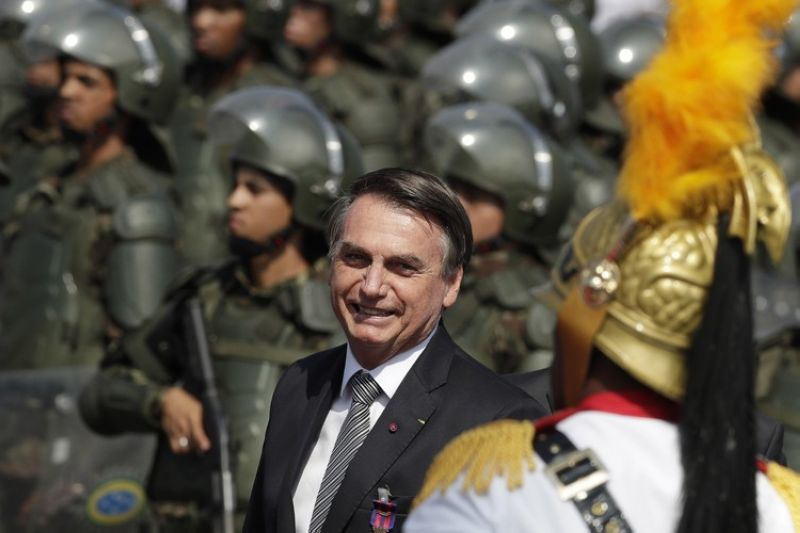 BRASILIA, BRAZIL. Brazil's President Jair Bolsonaro arrive to attend a military ceremony for the Day of the Soldier, at Army Headquarters in Brasilia, Brazil, Friday, August 23, 2019. Bolsonaro said he's leaning toward sending the army to help fight Amazon fires that have alarmed people across the globe. (AP)