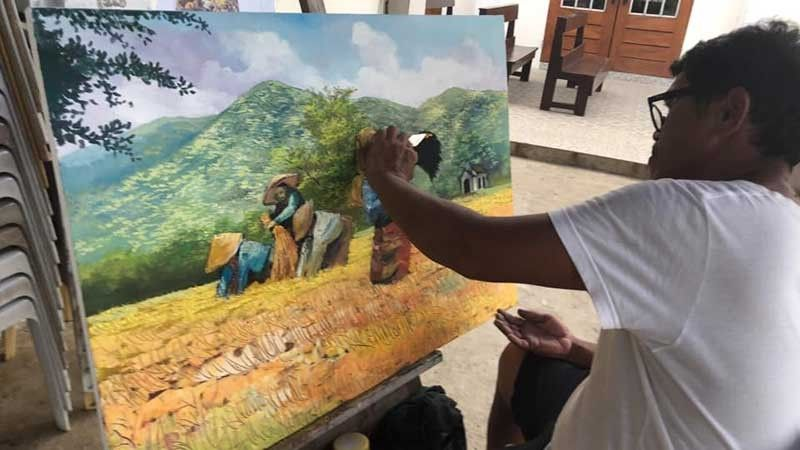 TACLOBAN. Resident painter Ernesto Kardante works on another commissioned oil painting to help build the first St. Josemaria Escriva Mission Station Church in Tacloban City. (Contributed photo)